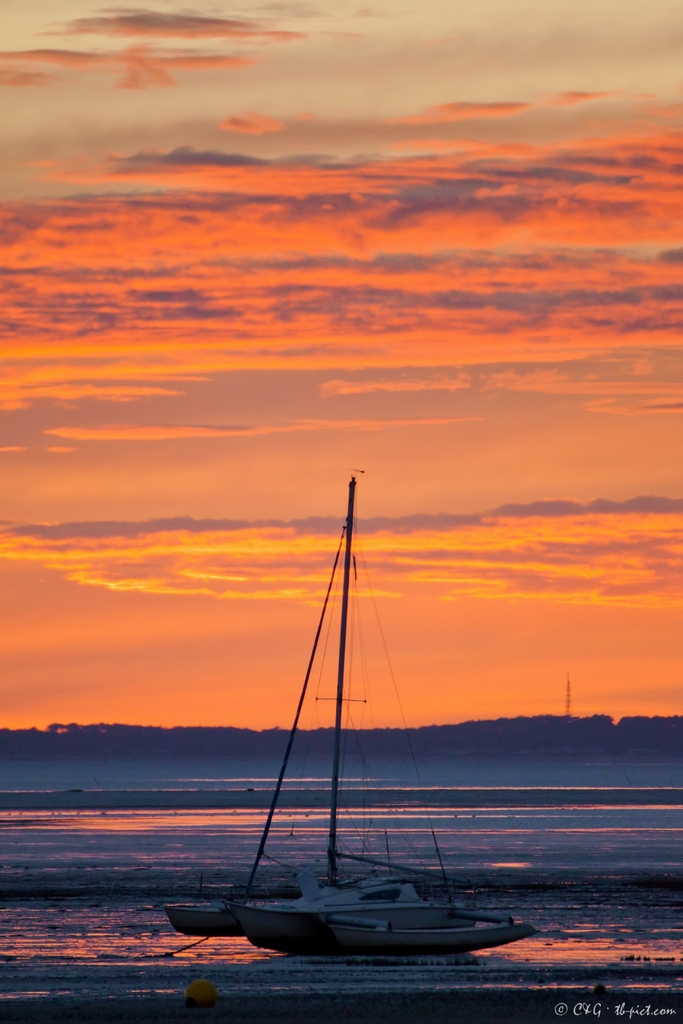 low tide sunset trimaran